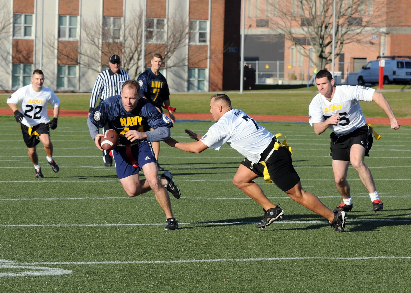 US Navy 111202 N FC065 001 Cmdr. Bill Mallory tries for more yards after a reception during a flag football game celebrating the annual Army Navy f